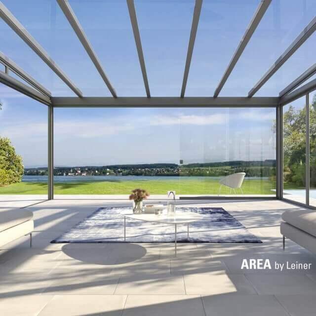 Erweiterter Wohnbereich mit AREA exclusiv mit Blick in den Garten